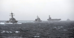 From left, the guided missile destroyer USS Truxtun (DDG 103), the guided missile cruiser USS Philippine Sea (CG 58), the aircraft carrier USS George H.W. Bush (CVN 77) and the guided missile cruiser USS Leyte Gulf (CG 55) steam in formation during a strait transit exercise in the Atlantic Ocean Dec. 10, 2013. The ships were part of the George H.W. Bush Carrier Strike Group and were participating in a composite training unit exercise in preparation for a scheduled deployment.