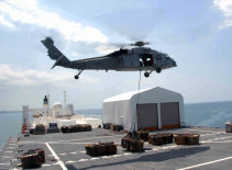 (April 14, 2009) An MH-60S Sea Hawk helicopter from Helicopter Sea Combat Squadron Two Six carries one of the 333 loads of cargo from the Military Sealift Command hospital ship USNS Comfort (T-AH 20) as the ship is anchored offshore near Port-Au-Prince. Comfort is deployed to Latin America and the Caribbean region as part of the four-month humanitarian and civic assistance mission Continuing Promise 2009. (U.S. Army photo by Spc. Eric J. Cullen