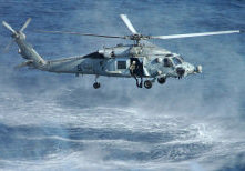 A Navy HH-60H Seahawk hovers over the Pacific Ocean as it prepares to put two swimmers attached to an Explosive Ordnance Disposal detachment in the water to detonate a simulated mine during a training exercise on March 8, 2005. EOD technicians routinely train to locate and disarm various explosive devices. The Seahawk is attached to Helicopter Anti- submarine Squadron 14 of Naval Air Station Atsugi, Japan. The EOD technicians and the Seahawk are operating from the aircraft carrier USS Kitty Hawk (CV 63).