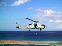 Caribbean Sea (Jan. 2003) -- One of two Naval Air System Command�s (NAVAIR) MH-60R Knighthawk helicopters conducts an airborne low frequency sonar (ALFS) operation during testing and evaluation at the Atlantic Undersea Test and Evaluation Center (AUTEC). Pilots logged 126 hours on the two helicopters in three weeks and captured all of the data required by the test plan.