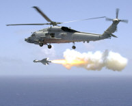 The Pacific Ocean, Jul. 23, 2002 � An SH-60B Sea Hawk of Helicopter Antisubmarine Light Five One (HSL-51) fires an AGM-119 Penguin anti-ship missile during aircrew weapons certification. The certification took place over the Pacific Ocean off the coast of Okinawa, Japan. HSL-51 is home based at the forward deployed naval facility in Atsugi, Japan, with detachments operating out of Kadena Air Force Base in Okinawa. U.S. Navy photo by Photographer's Mate 2nd Class Lisa Aman.