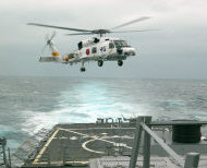 PHILIPPINE SEA (March 17, 2007) - An SH-60J Seahawk assigned to the Japan Maritime Self Defense Force (JMSDF) ship JS Haruna (DDH 141) makes a landing aboard the guided missile destroyer USS Russell (DDG 59). Russell is part of the USS Ronald Reagan Carrier Strike Group and is participating in a three-day passing exercise with JMSDF ships. U.S. Navy photo by Gas Turbine System Technician (Mechanical) Fireman Derek Webster
