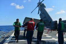 U.S. Sailors extend the tail of an MH-60R Seahawk helicopter attached to Helicopter Maritime Strike Squadron (HSM) 70 on the flight deck of the guided missile destroyer USS Truxtun (DDG 103) in the Atlantic Ocean Aug. 7, 2013. The Truxtun participated in the George H.W. Bush group sail to improve strike group interoperability and prepare for an upcoming deployment.