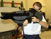Personnel halting and stimulation response rifle