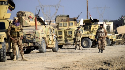 Iraqi soldiers advance their position in northern Ramadi, 70 miles west of Baghdad, on Monday.
