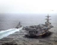 Royal Navy frigate HMS St Albans passes USS George W Bush during an exercise in the Middle East.