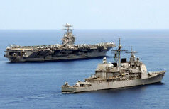 South China Sea (April 17, 2006) – Guided-missile cruiser USS Mobile Bay, foreground and Nimitz-class aircraft carrier USS Abraham Lincoln, through the South China Sea. Lincoln and embarked Carrier Air Wing Two (CVW-2) are currently underway to the Western Pacific for a scheduled deployment. U.S. Navy photo by Mass Communication Specialist Seaman Justin R. Blake