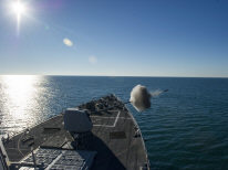 The forward Mark 45 5-inch gun aboard the guided missile destroyer USS Truxtun (DDG 103) fires during a live-fire exercise in the Atlantic Ocean Dec. 16, 2013. The Truxtun was part of the George H.W. Bush Carrier Strike Group and was underway participating in a final evaluation problem in preparation for a scheduled deployment.