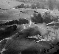 Aerial view of the Kuwaiti oil fires. Date 1991. Author: Robert Bumpas, of the National Science Foundation
